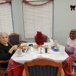 Two women residents eating dinner.