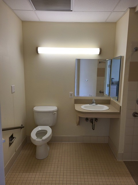 Bathroom with toilet and sink.